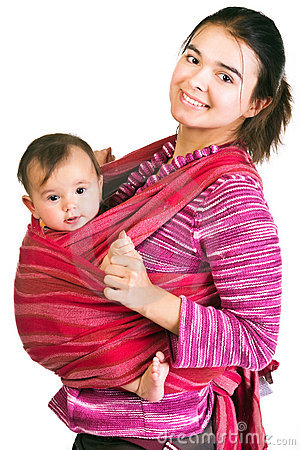 Modern young mother carrying baby in a sling