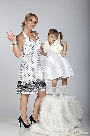Modern young mother and daughter