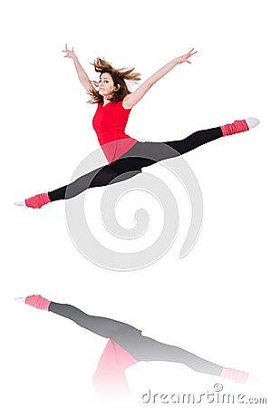 Młody gimnastyczki ćwiczyć