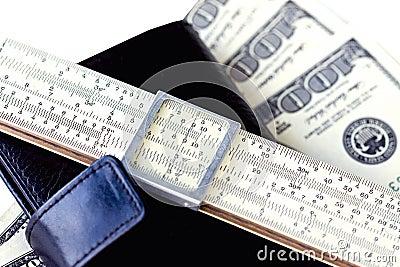 Moleskin, scale ruler, and hundred dollar bills