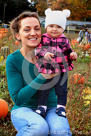 Free Mom And Baby In Pumpkin Patch Royalty Free Stock Photo - 63943755