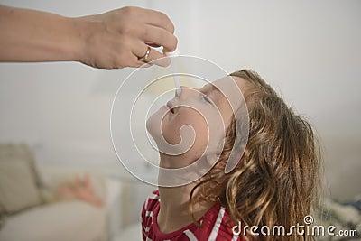 Mom applying nose drops
