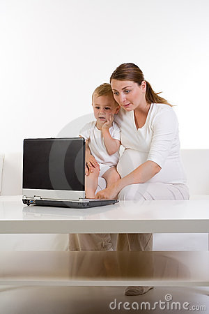 Mom and baby using laptop