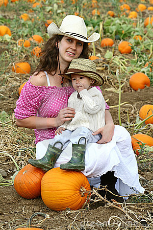 Mom and Child in a Pumpkin Patch