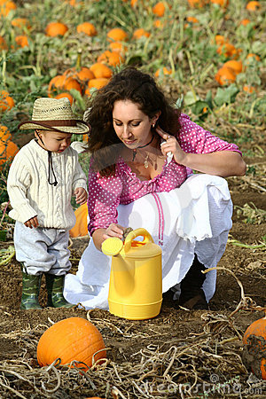 Mom and Child with Watering Can