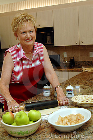 Free Mom Cooking Apple Pie Stock Image - 3585041