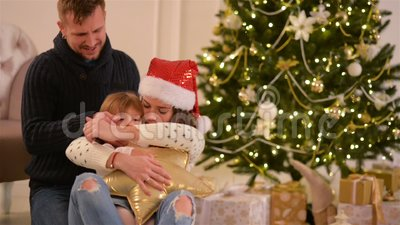 mom dad and little baby daughter loving family merry christmas and happy new year cheerful pretty people parents stock footage video of indoor
