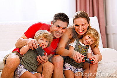 Mom and dad playing with daughter on console