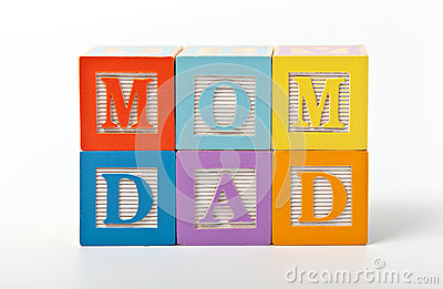 Mom and dad words written with play blocks
