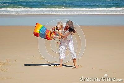 Mom, daughter, beach fun