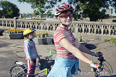Mom and daughter on the bicycles