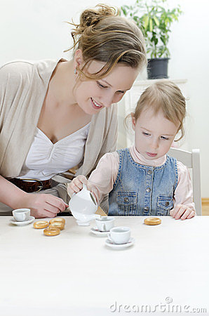 Mom and daughter having tea