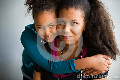 Mom and daughter hug