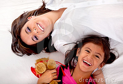 Mom and daughter lying