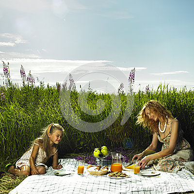 Mom and daughter at a picnic