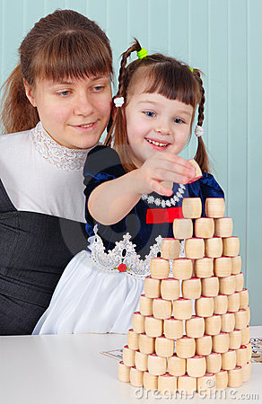 Mom and daughter play - to build a tower