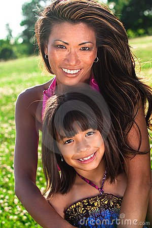 Mom and daughter posing