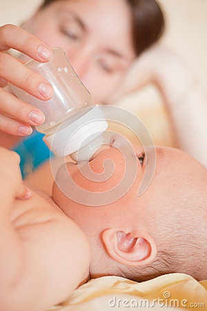 Mom feed baby with bottle