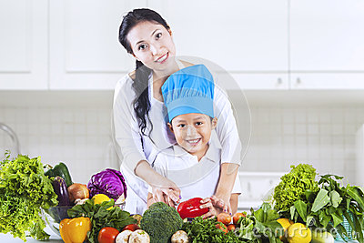 Mom and chef boy in kitchen