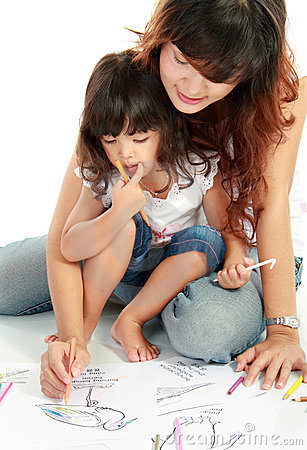 Mom and her little daughter drawing together