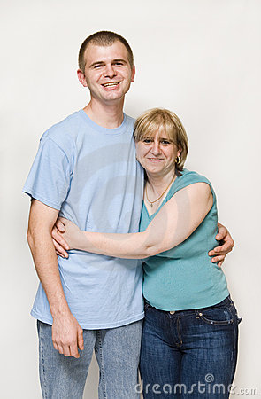 Mom hugging adult son