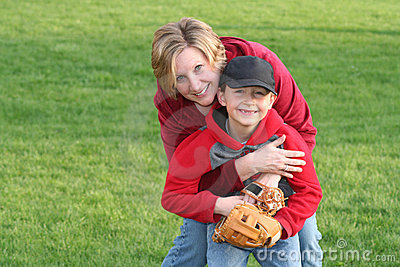 Mom Hugging Young Sports Son