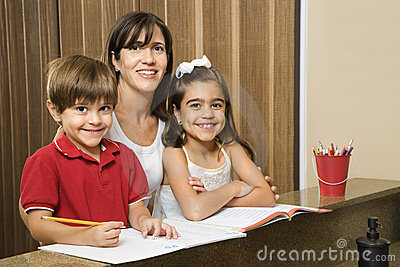 Mom and kids with homework.