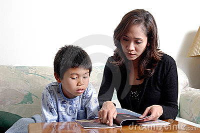 Mom reading with son