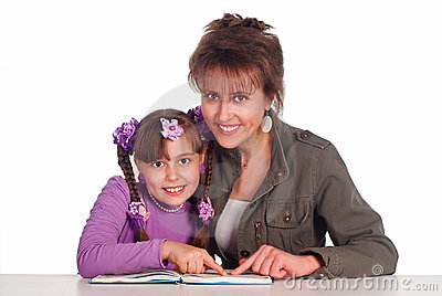 Mom reads with daughter