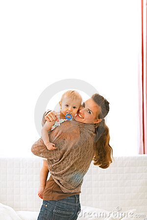 Mom showing baby something by pointing in camera