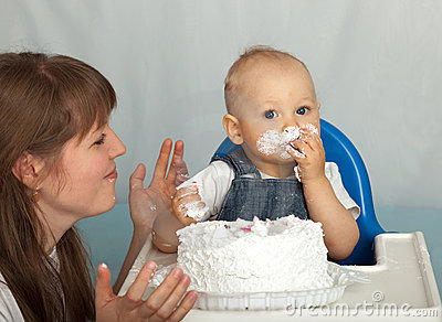 Mom and son eating cake.