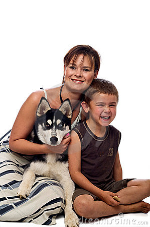 Mom and son posing with dog.