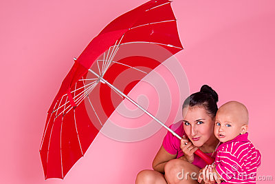 Mom and son under a red umbrella