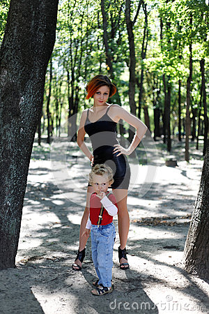 Mom and son on a walk in park