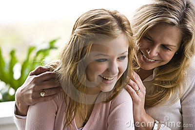 Mom and teenage daughter laughing