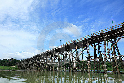 Mon wooden bridge against blue sky at Sangklaburi