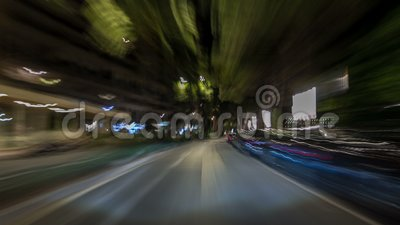 Monaco city roads traffic at night with car light trails timelapse hyperlapse drivelapse. Illuminated streets and buildings stock footage