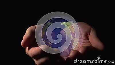 Monde dans des vos mains banque de vidéos