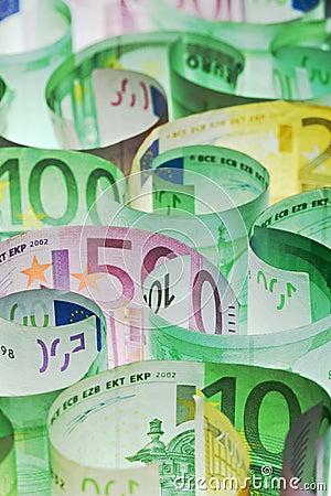 Money background - euro banknotes under lit