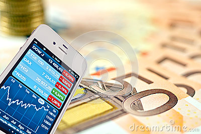 Money background and iphone trade charts Editorial Stock Photo