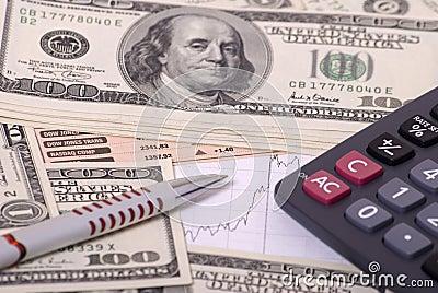 Money, calculator, graphand pen