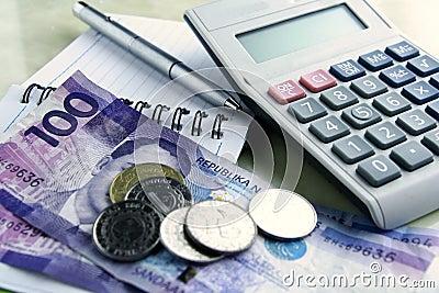 Money, calculator, notebook and pen