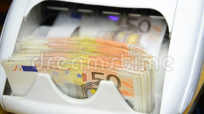 Money counts the 50 euro notes. Cash money counter and detector of banknotes for the count of notes and determination of fake money counts the 50 euro notes