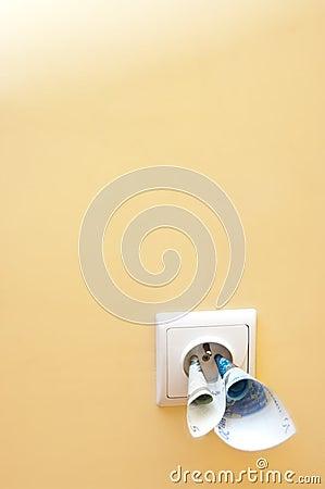 Money in electrical socket
