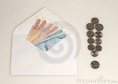 Money in envelope and exclamation mark from coins
