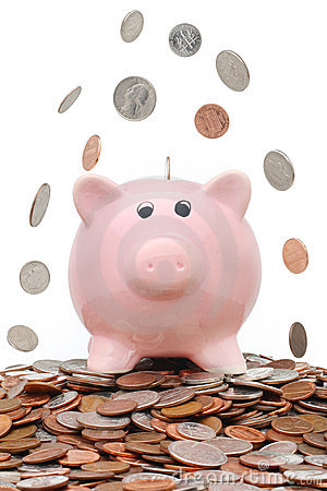 Money falling over a piggy bank
