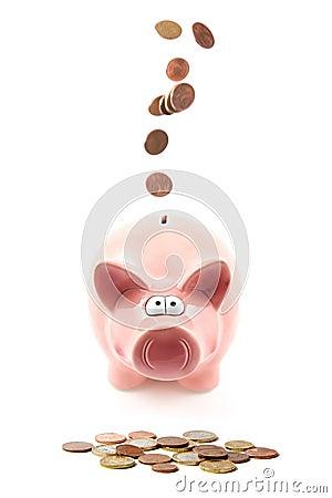 Money falling through piggy bank