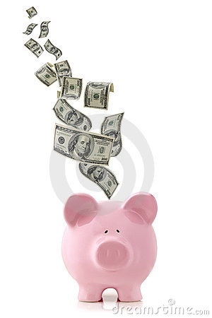 Money Falling into Piggy Bank