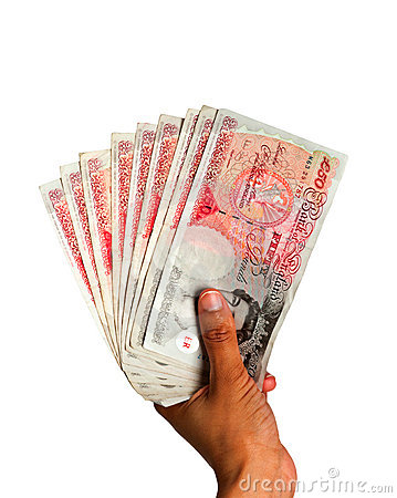 Money held in hand - UK Currency Editorial Stock Image