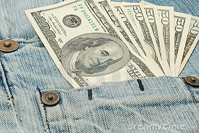 Money in jeans pocket - dollars
